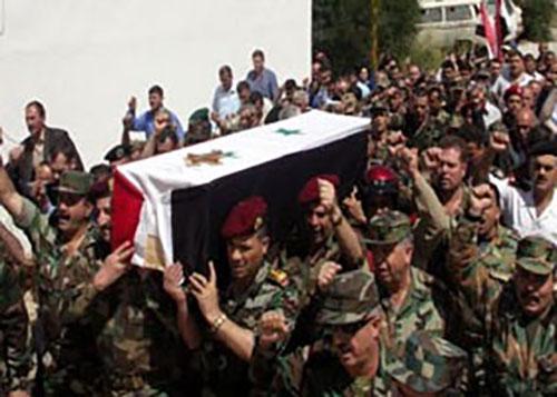 تشييع شهيد في الجيش السوري
