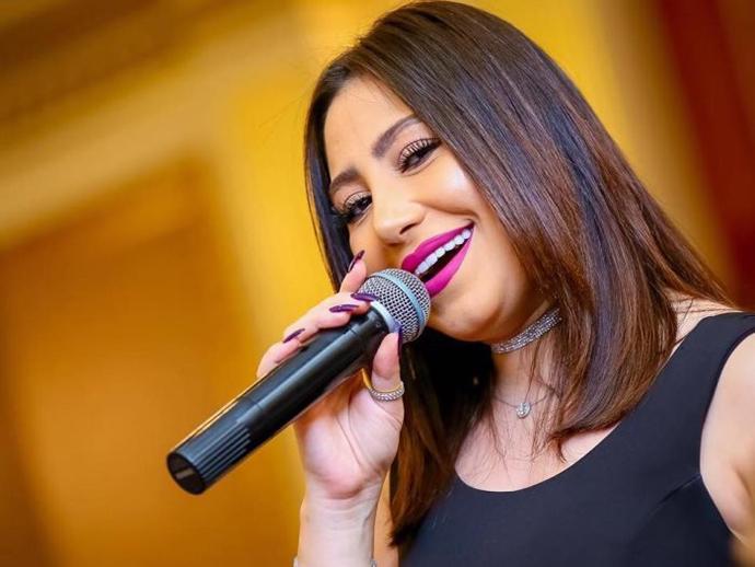 المغنية بوسي